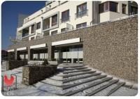 Akmeninis fasadas - gabionas